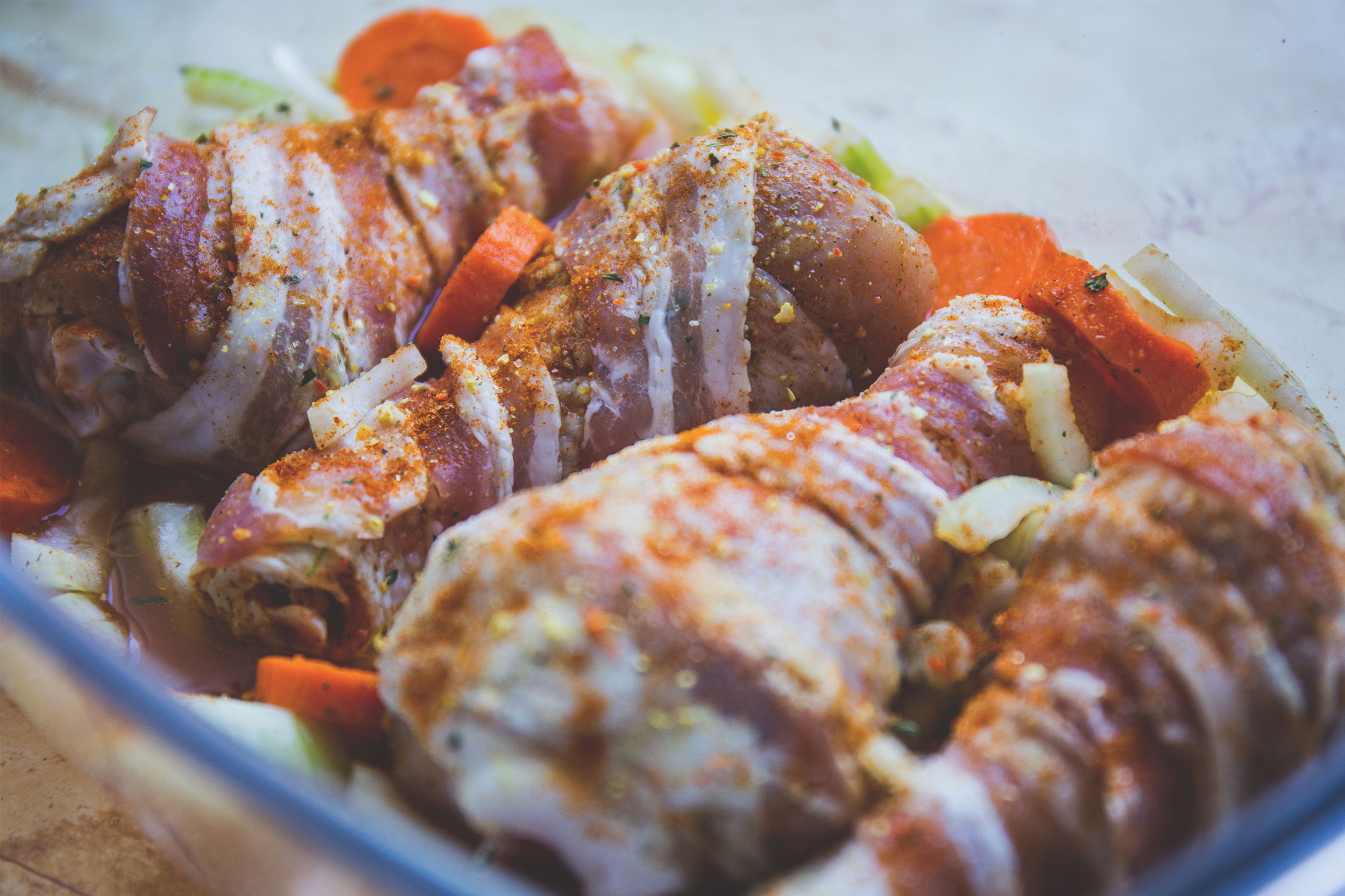 Marios Italian Deli | Picture of Bacon-Wrapped Drumsticks with Vegetables